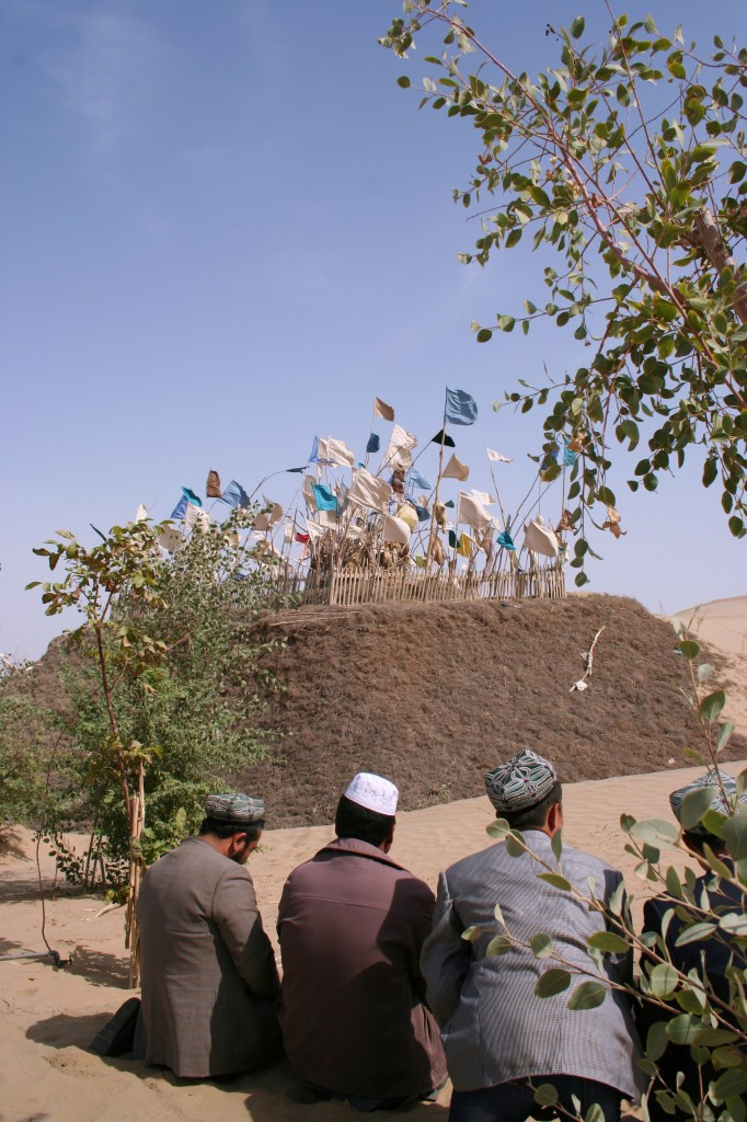 Uyghur men at the shrine - photograph by author.